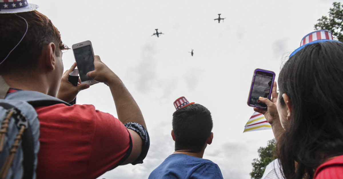 WASHINGTON, DC - JULY 04: People cheer during a fly over on the National Mall during President Donald Trump's speech during Fourth of July festivities on July 4, 2019 in Washington, DC. President Trump is holding a