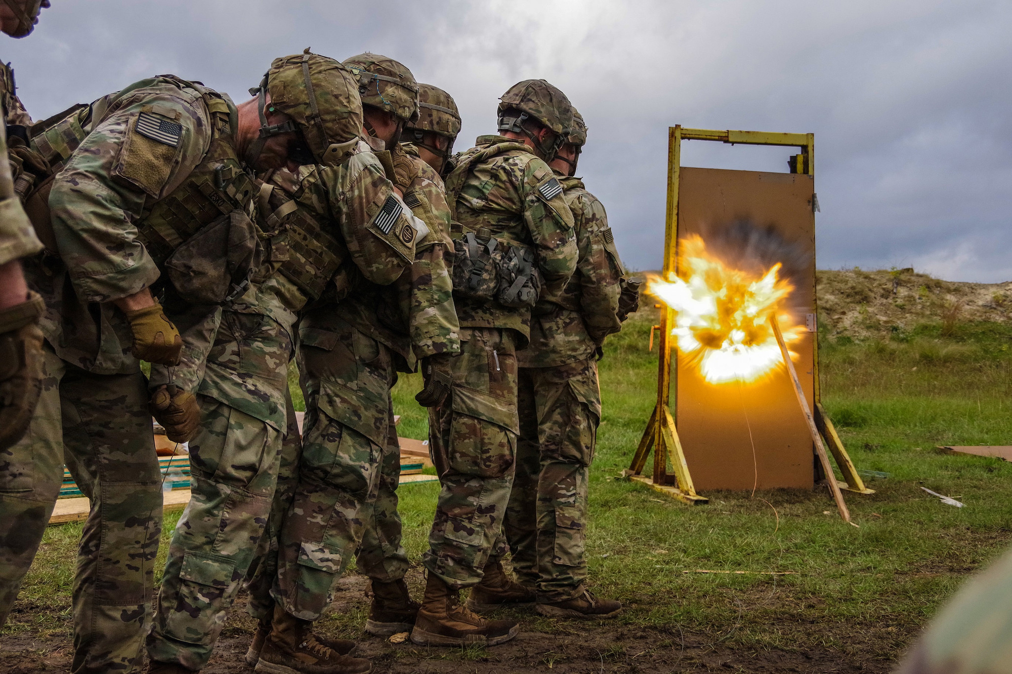 Paratroopers from Company A, 307th Airborne Engineer Battalion, 3rd Brigade Combat Team, 82nd Airborne Division observe as a door-breaching charge they emplaced detonates Nov. 6, 2018, on Fort Bragg, N.C. (Army)