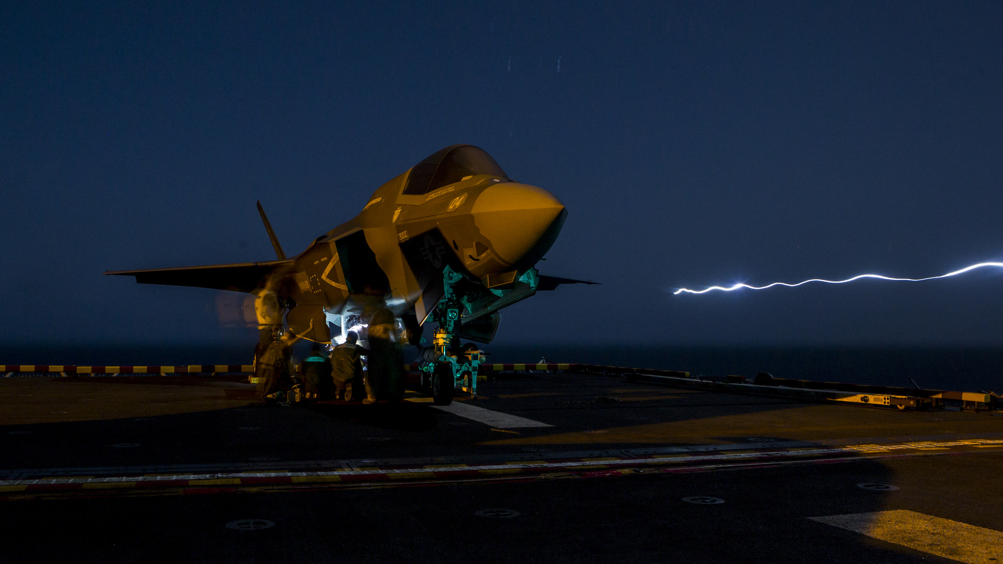 U.S. Marines with Marine Fighter Attack Squadron 211, 13th Marine Expeditionary Unit (MEU), load ordnance into an F-35B Lightning II aboard the Wasp-class amphibious assault ship USS Essex (LHD 2) on Sept. 27, 2018, in preparation for the F-35B's first combat strike. (Cpl. A. J. Van Fredenberg/Marine Corps)