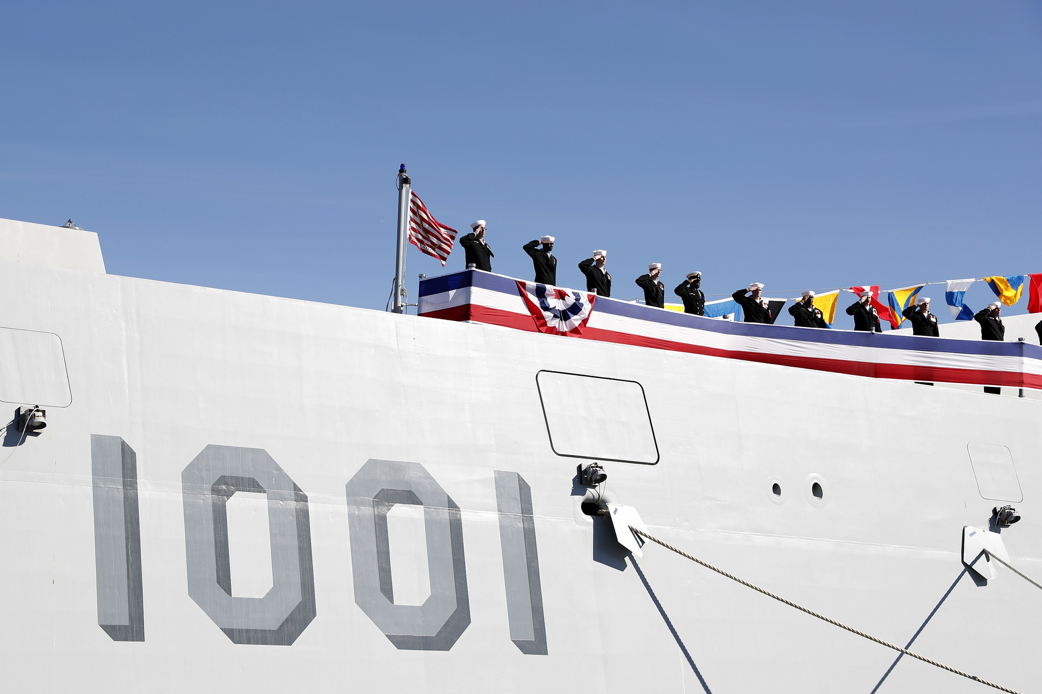 The crew of the Zumwalt-class guided-missile destroyer USS Michael Monsoor (DDG 1001) brings the ship to life during its commissioning ceremony on Jan. 26, 2019, in San Diego. Michael Monsoor is the second Zumwalt-class destroyer to enter the fleet. It is the first Navy combat ship named for fallen Master-at-Arms 2nd Class (SEAL) Michael Monsoor, who was posthumously awarded the Medal of Honor for his heroic actions while serving in Ramadi, Iraq, in 2006. (Mass Communication Specialist 1st Class Peter Burghart/Navy)