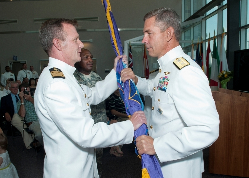 Retired Navy Capt. Jeffrey Breslau, left, pleaded guilty Tuesday to providing public affairs services to