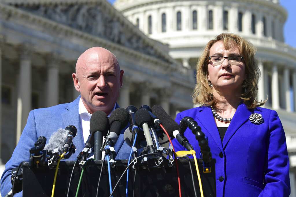 In this Oct. 2, 2017, photo, former Rep. Gabrielle Giffords, D-Ariz., right, listens as her husband Mark Kelly, left, speaks on Capitol Hill in Washington. Kelly kicked off his U.S. Senate campaign on Saturday with a rally in Tucson (Susan Walsh/AP)