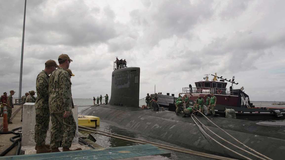 Sailors assigned to the fast-attack submarine Indiana secure mooring lines to the sub. Indiana returned to Naval Station Norfolk on Sept. 16, following a sortie due to Hurricane Florence. Indiana is the Navy's newest Virginia-class submarine and will commissioned in Port Canaveral, Florida, on Sept. 29. (Mass Communication Specialist 2nd Class Sonja Wickard/Navy)