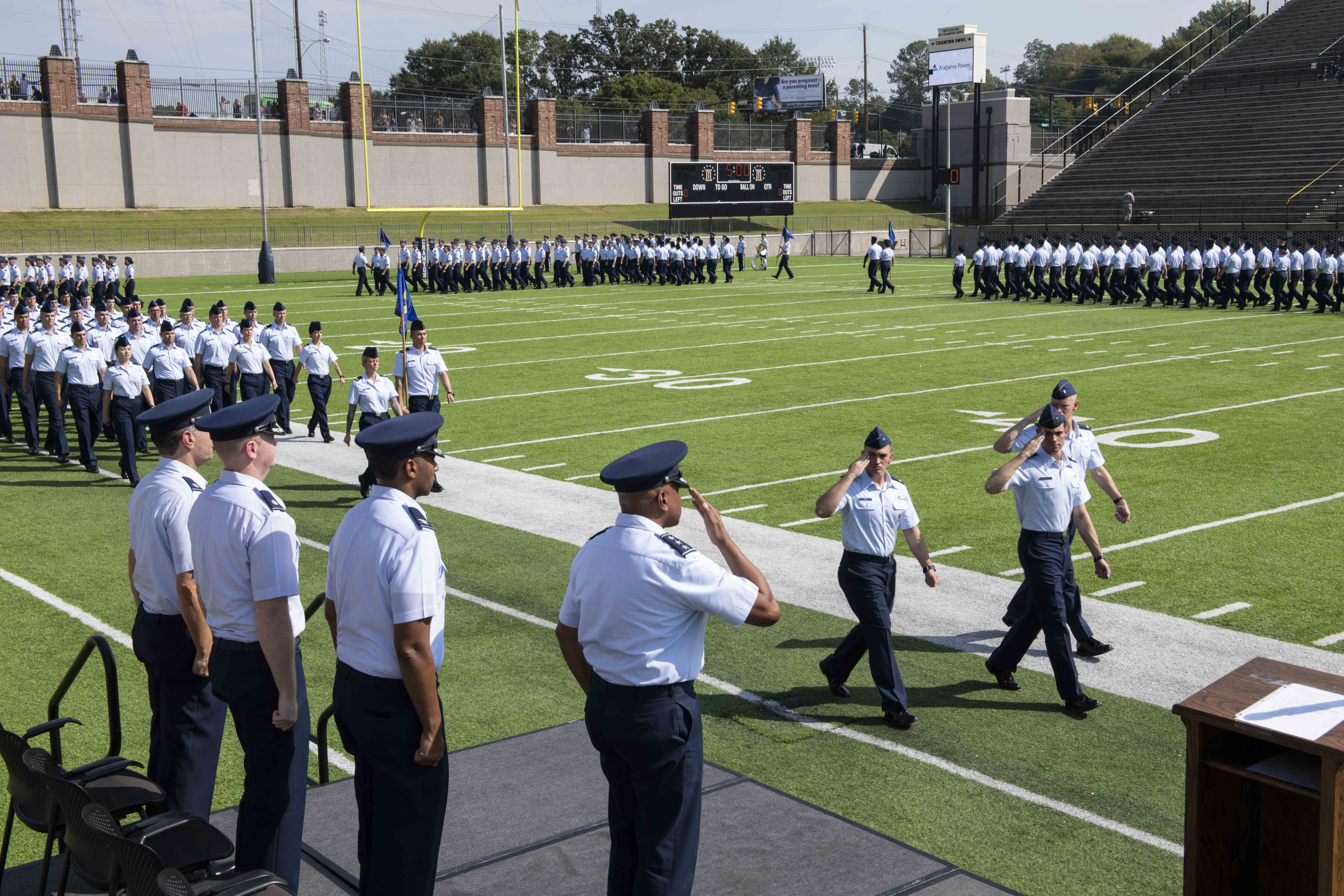 """The Air Force's newest second lieutenants perform the pass and review during their graduation ceremony at the Cramton Bowl football field Sept. 27, 2019, Montgomery, Alabama. Officer Training School's class 19-07, also known as """"Godzilla Class,"""" spent the last eight weeks taking part in a series of field training and classroom leadership exercises preparing them to become Air Force officers. (Senior Airman Alexa Culbert/Air Force)"""