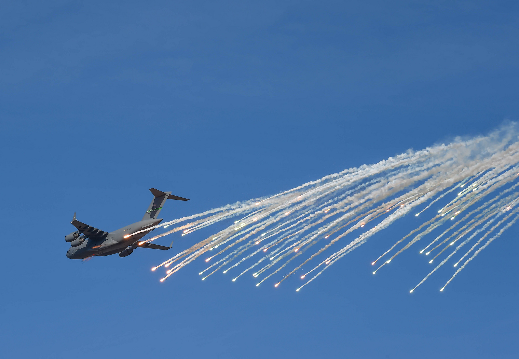 A C-17 Globemaster III, from Joint Base Lewis-McChord, Wash., releases flares above the Selah Airstrip over Yakima Training Center, Nov. 15, 2018. (Senior Airman Tryphena Mayhugh/Air Force)