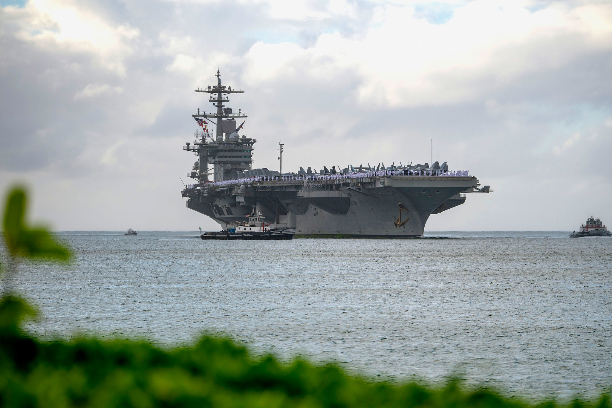 The aircraft carrier USS Abraham Lincoln (CVN 72) arrives at Joint Base Pearl Harbor-Hickam on Jan. 8, 2020, as part of an around-the-world deployment that includes a homeport shift to San Diego. (Mass Communication Specialist 3rd Class Aja B. Jackson/Navy)