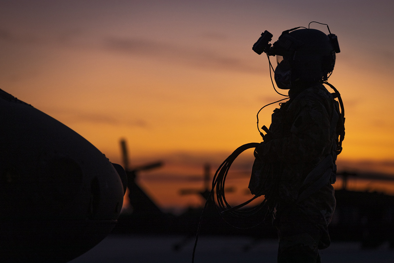 U.S. Army Sgt. Joseph Koszyk, a UH-60M Black Hawk helicopter crew chief with the New Jersey National Guard, prepares his aircraft for a night training mission at Joint Base McGuire-Dix-Lakehurst, N.J., Sept. 18, 2019. (Master Sgt. Matt Hecht/Air National Guard)