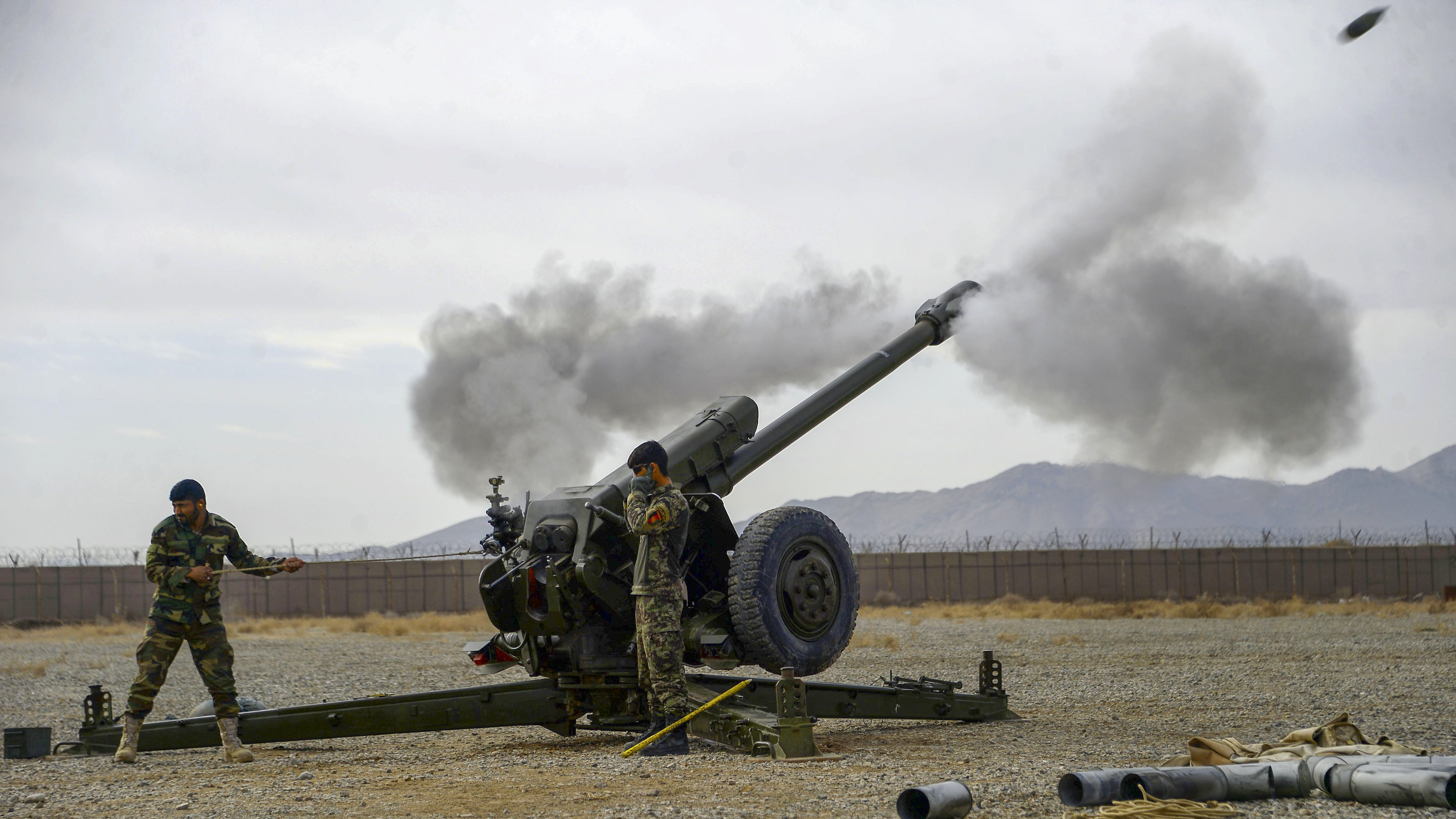 Afghan National Army (ANA) soldiers fire a D30 122mm Howitzer gun during a training session on Feb. 2, 2019, for ANA soldiers at Arena base in the Guzara district of Herat province. (HOSHANG HASHIMI/AFP/Getty Images)