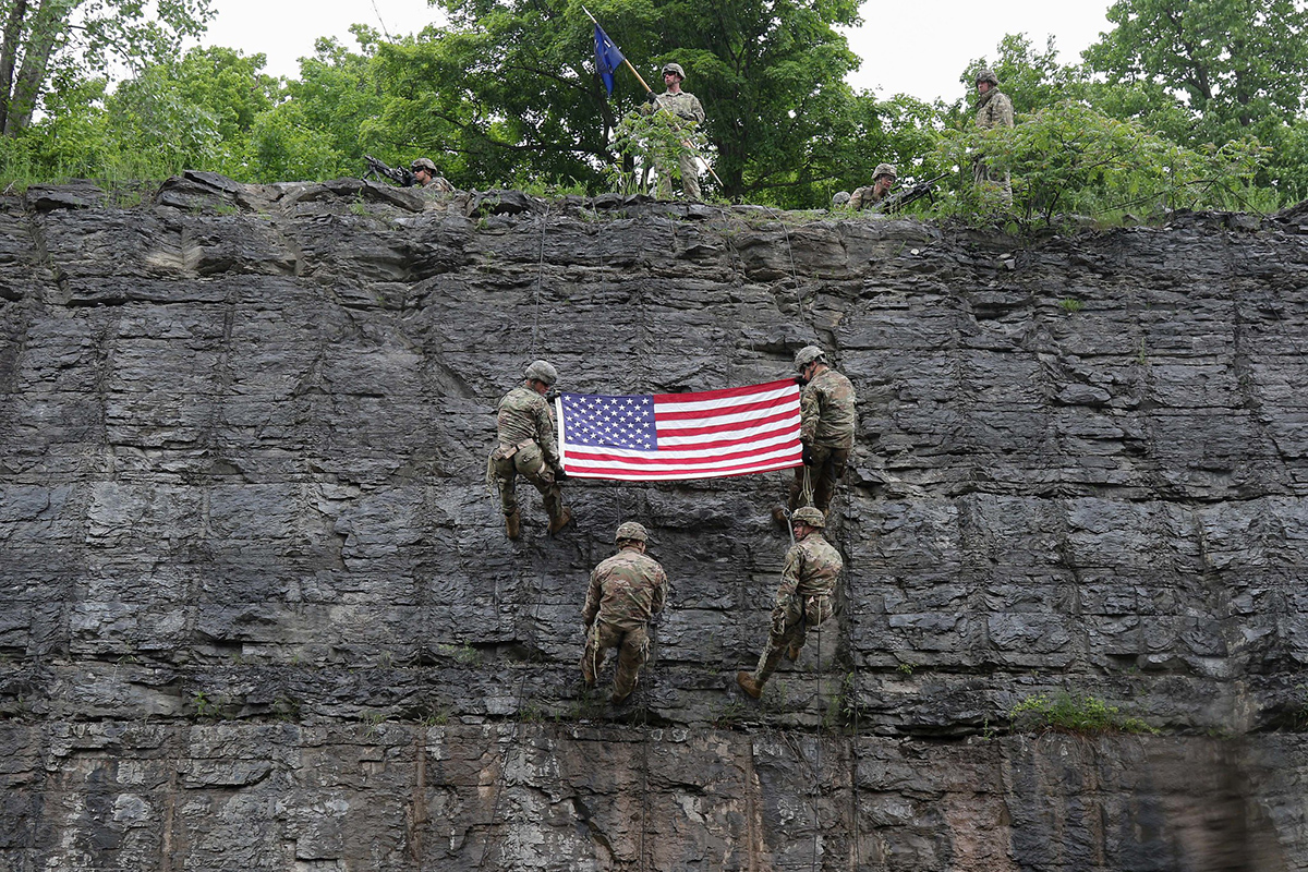 Spc. Scott Myers, lower left, re-enlists during rock face rappel training at Fort Drum, N.Y., June 13, 2019.