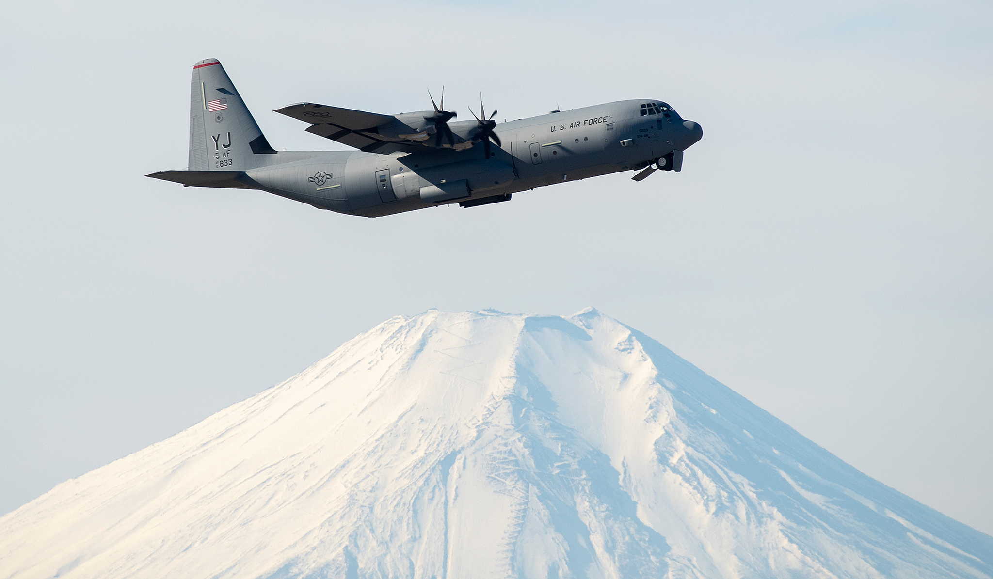 An Air Force C-130J Super Hercules flies over Yokota Air Base, Japan, during a training mission. (Yasuo Osakabe/Air Force)