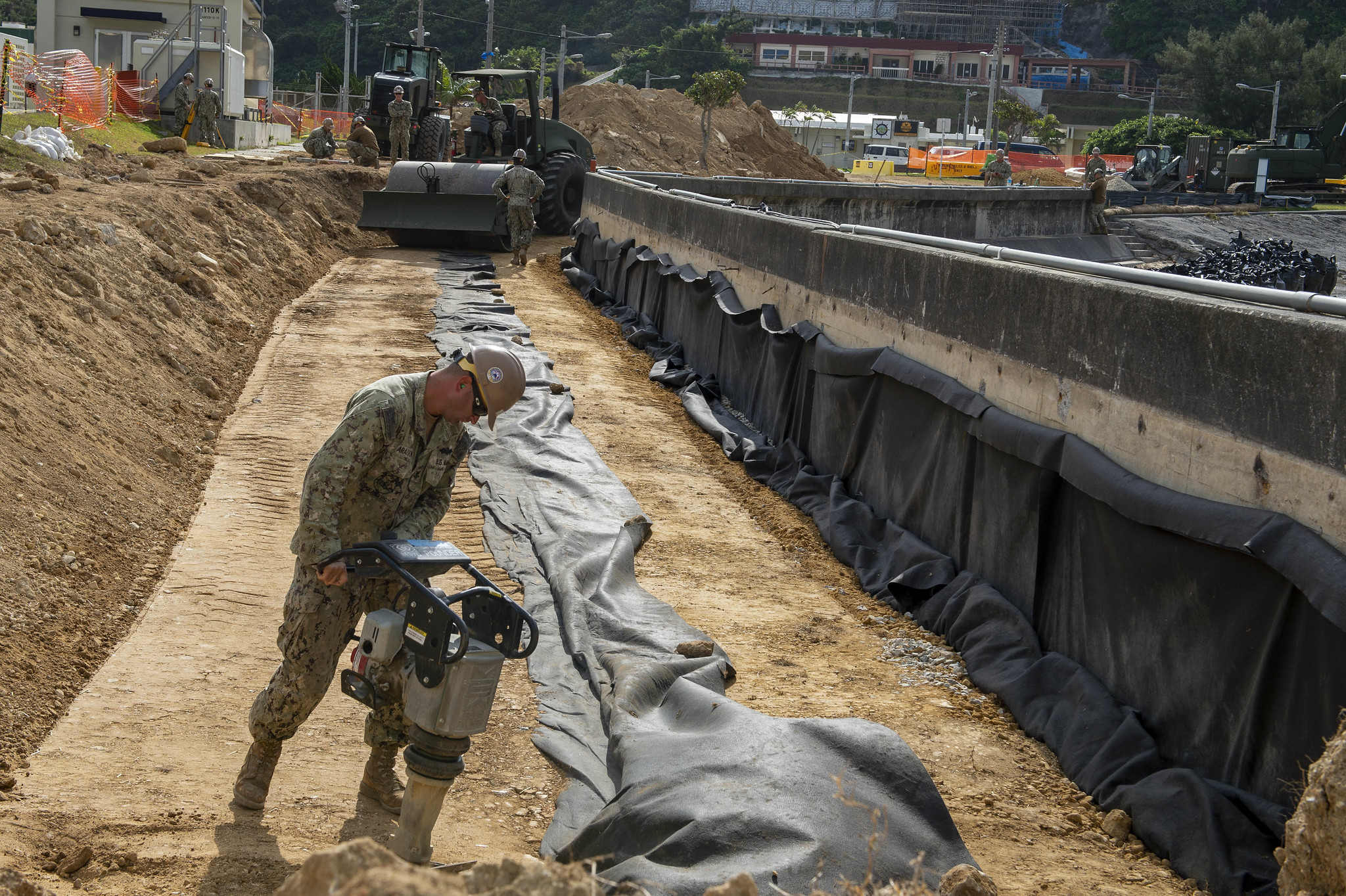Equipment Operator 2nd Class Aragon Luis operates a compactor at the seawall project at White Beach Naval Facility on Feb. 8, 2020, in Okinawa, Japan. (Mass Communication Specialist 1st Class Stephane Belcher/Navy)