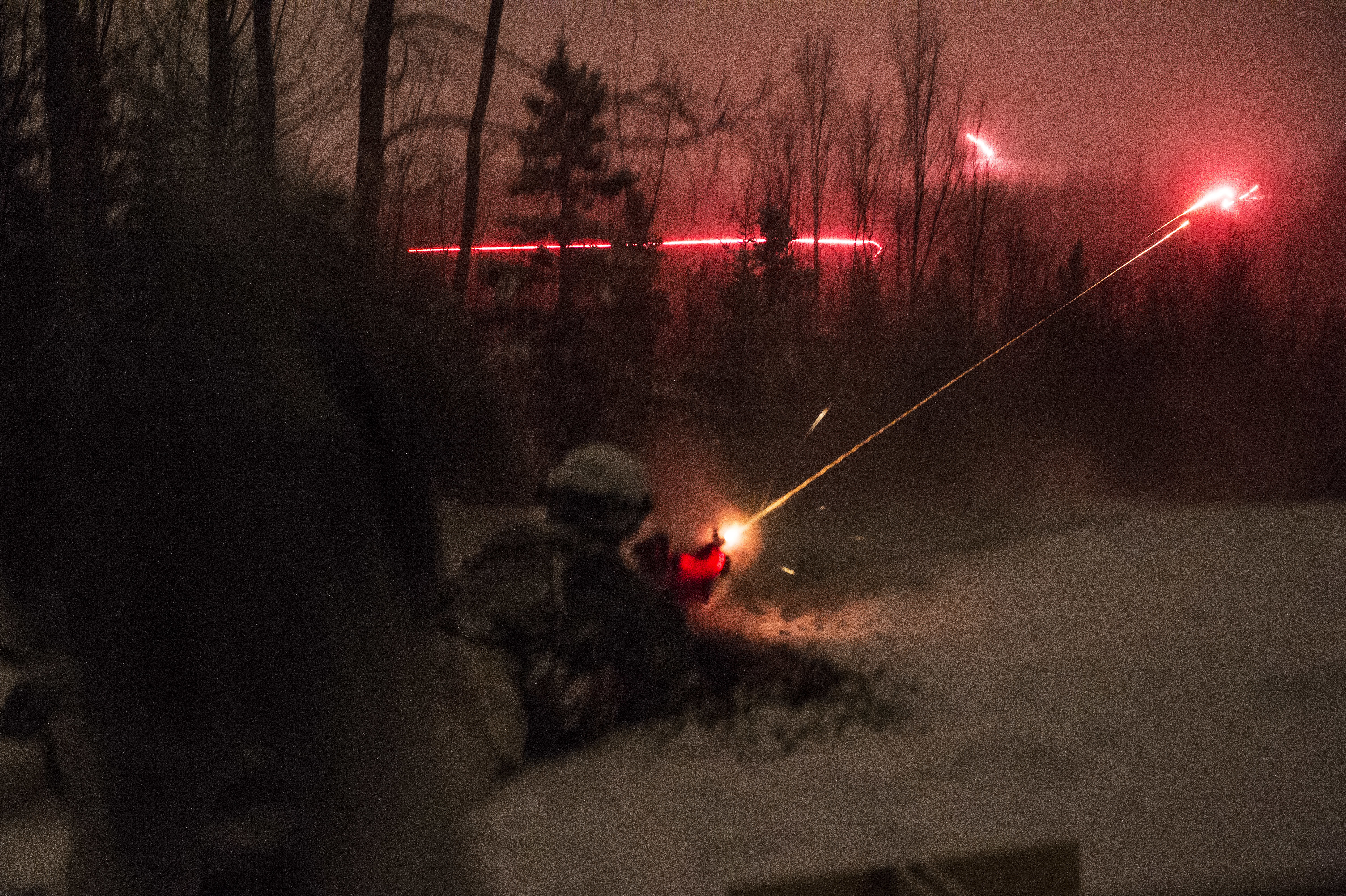 Soldiers provide fire support while conducting a night assault during Operation Punchbowl at Joint Base Elmendorf-Richardson, Alaska, Feb. 10, 2018. (Alejandro Peña/Air Force)