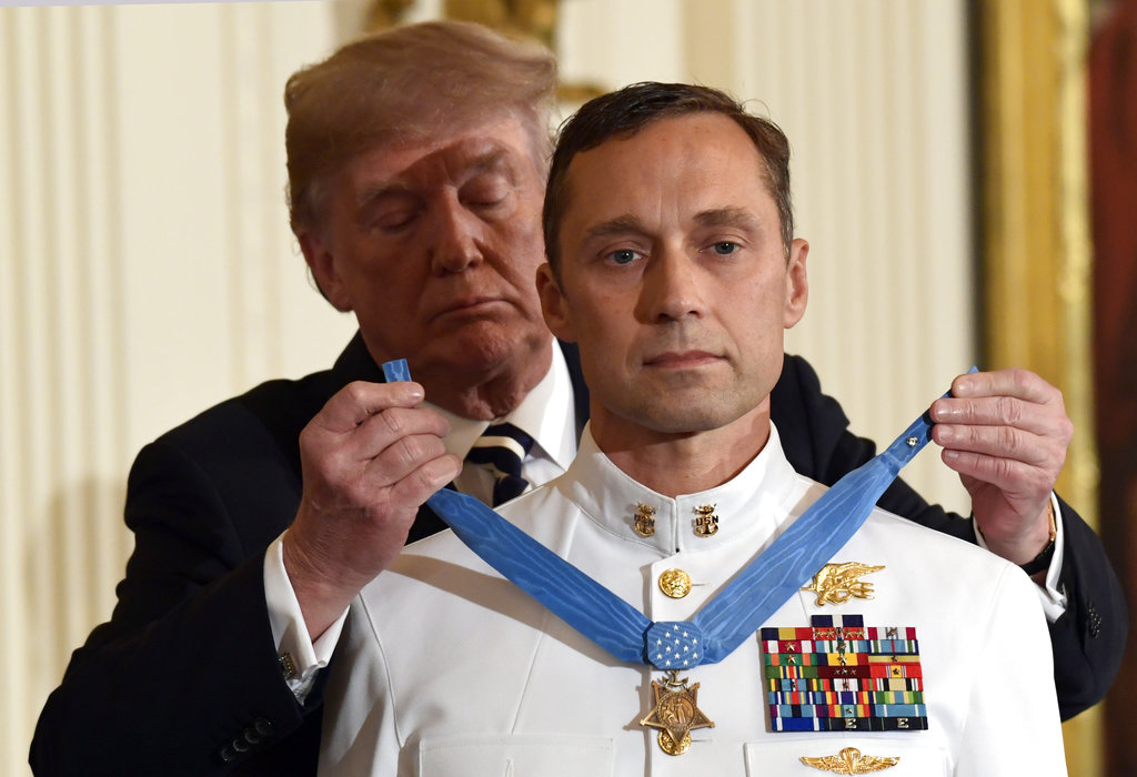 President Donald Trump awards the Medal of Honor to Master Chief Special Warfare Operator Britt K. Slabinski during a ceremony in the East Room of the White House in Washington, Thursday, May 24, 2018. Slabinski oversaw a daring 2002 assault and rescue mission on a snowy Afghanistan mountaintop and carried a