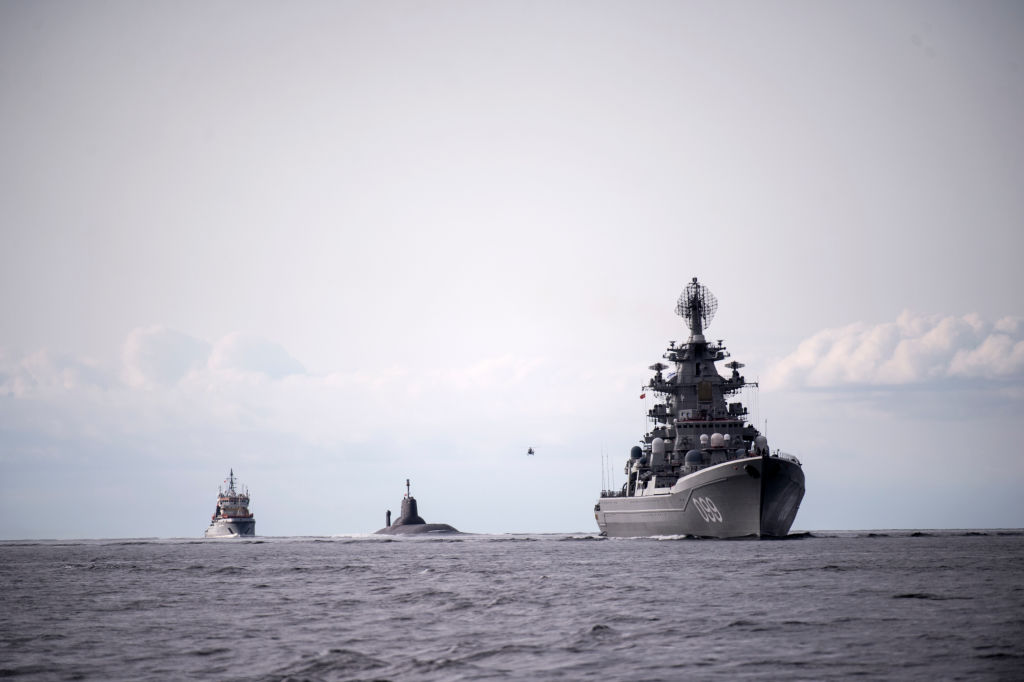 The Russian nuclear submarine Dmitrij Donskoj, center, sails through Danish waters, near Korsor, on July 21, 2017, on it's way to Saint Petersburg to participate in the 100th anniversary of the Russian Navy, held July 29-30. The submarine is 172 meters long and is thus the largest nuclear-powered submarine in the world. It's the first time it sailed into the Baltic Sea. (Sarah Christine Noergaard/AFP/Getty Images)
