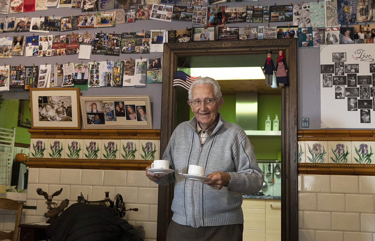 In this photo taken on Thursday, Nov. 7, 2019, Marcel Schmetz serves coffee from the kitchen of his house at the Remember Museum 39-45 in Thimister-Clermont, Belgium. (Virginia Mayo/AP)