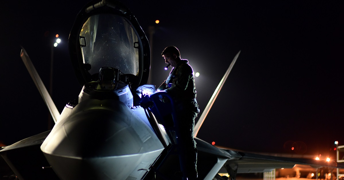 An F-22 Raptor pilot with the 95th Fighter Squadron performs a preflight inspection prior to night flying operations at Tyndall Air Force Base, Fla., June 11, 2018. (Airman 1st Class Isaiah Soliz/Air Force)