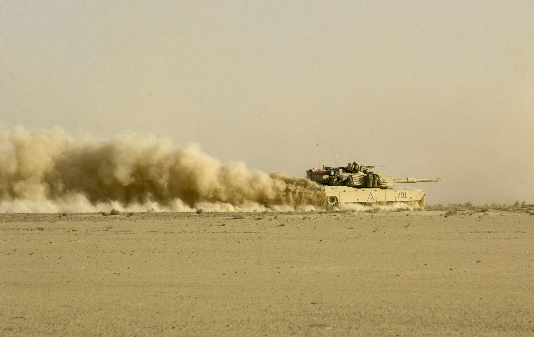 Troops from the U.S. Army's 3rd Squadron, 7th Cavalry Regiment on the move during invasion of Iraq on April 2, 2003. (Warren Zinn/Army Times)