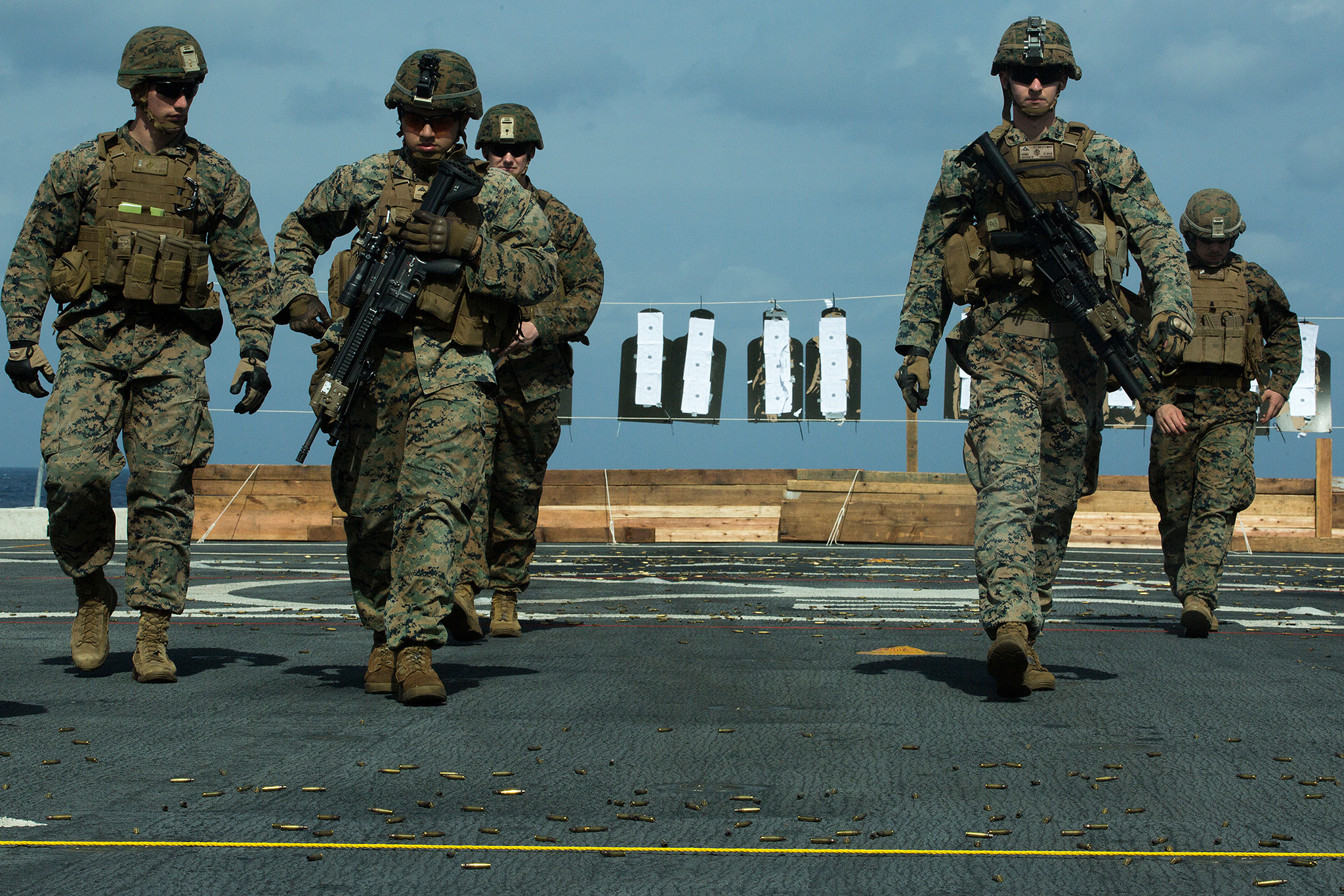 Marines walk back to the firing line during marksmanship training atop the flight deck of the amphibious transport dock USS Green Bay (LPD 20), in the East China Sea, Feb. 2, 2019. (Lance Cpl. Cameron E. Parks/Marine Corps)