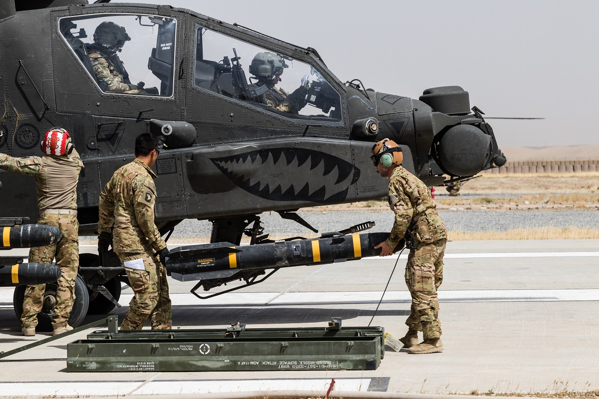 U.S. Army soldiers load an AGM-114 Hellfire missile on an AH-64E Apache helicopter in Kunduz, Afghanistan, May 31, 2017. The Joint Air-to-Ground Missile (JAGM) will replace Hellfire, going into production starting in FY18. (Photo by Capt. Brian Harris/U.S. Army)