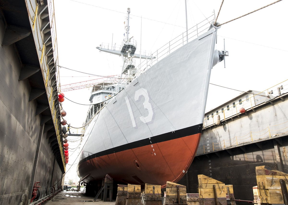 The U.S. Navy mine countermeasures ship Dextrous sits in dry dock for maintenance in Bahrain. The Navy is exploring a 30-year ship maintenance plan to better plan long-term costs of its fleet. (MC2 Victoria Kinney/Navy)