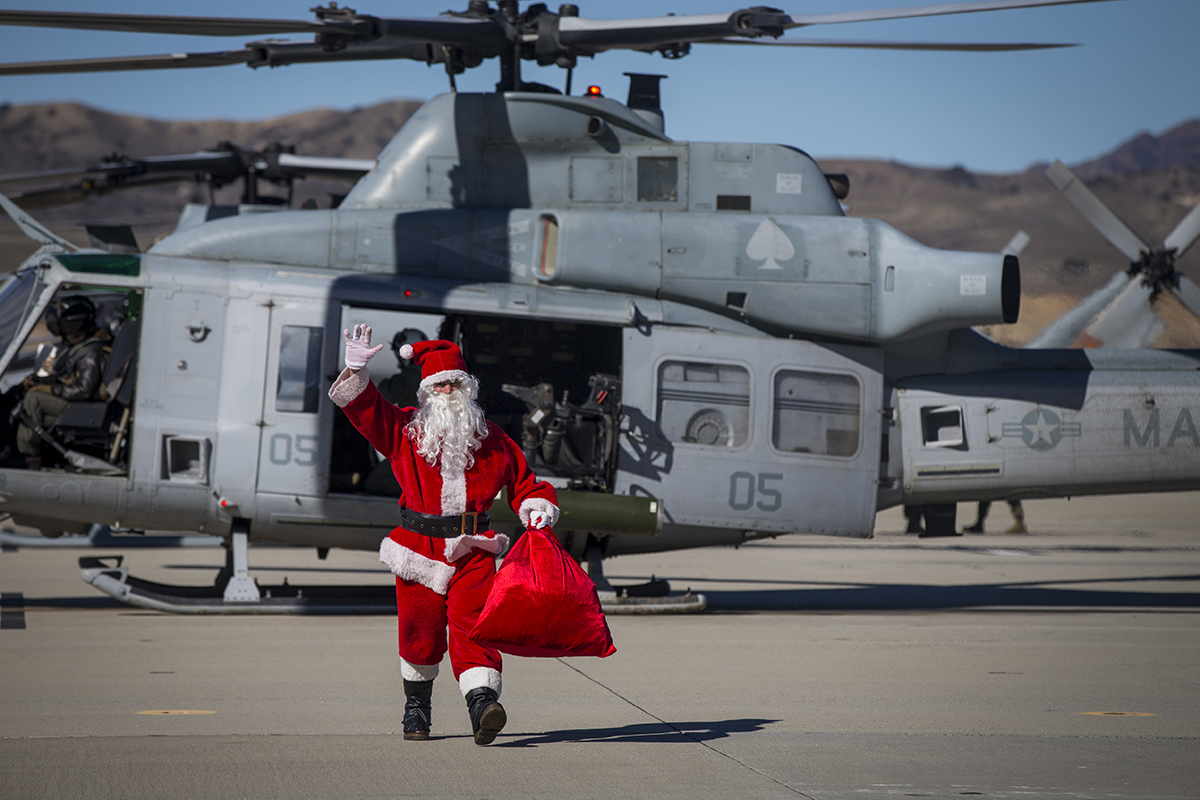 Santa Claus greets U.S. Marines assigned to Marine Light Attack Helicopter Squadron (HMLA) 469, Marine Aircraft Group 39, 3rd Marine Aircraft Wing, and their families during the HMLA-469 annual holiday party at Marine Corps Air Station Camp Pendleton, Calif., Dec. 8, 2018. (Cpl. Juan Bustos/Marine Corps)