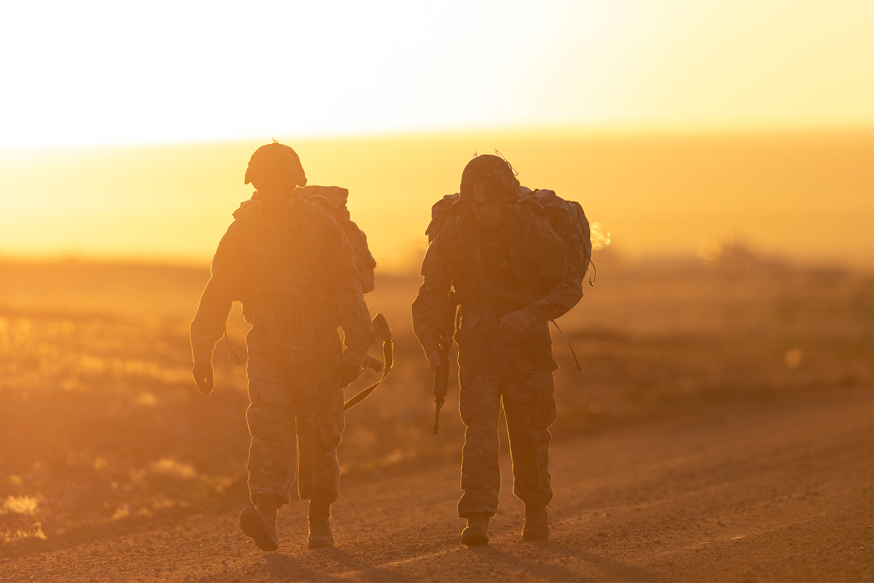 Army Spcs. Eduardo Siordia and Keith Zimmerman approach the midpoint of a 12-mile ruck march during the Best Warrior competition at Fort Carson, Colo., April 26, 2019. (Sgt. Micah Merrill/Army)