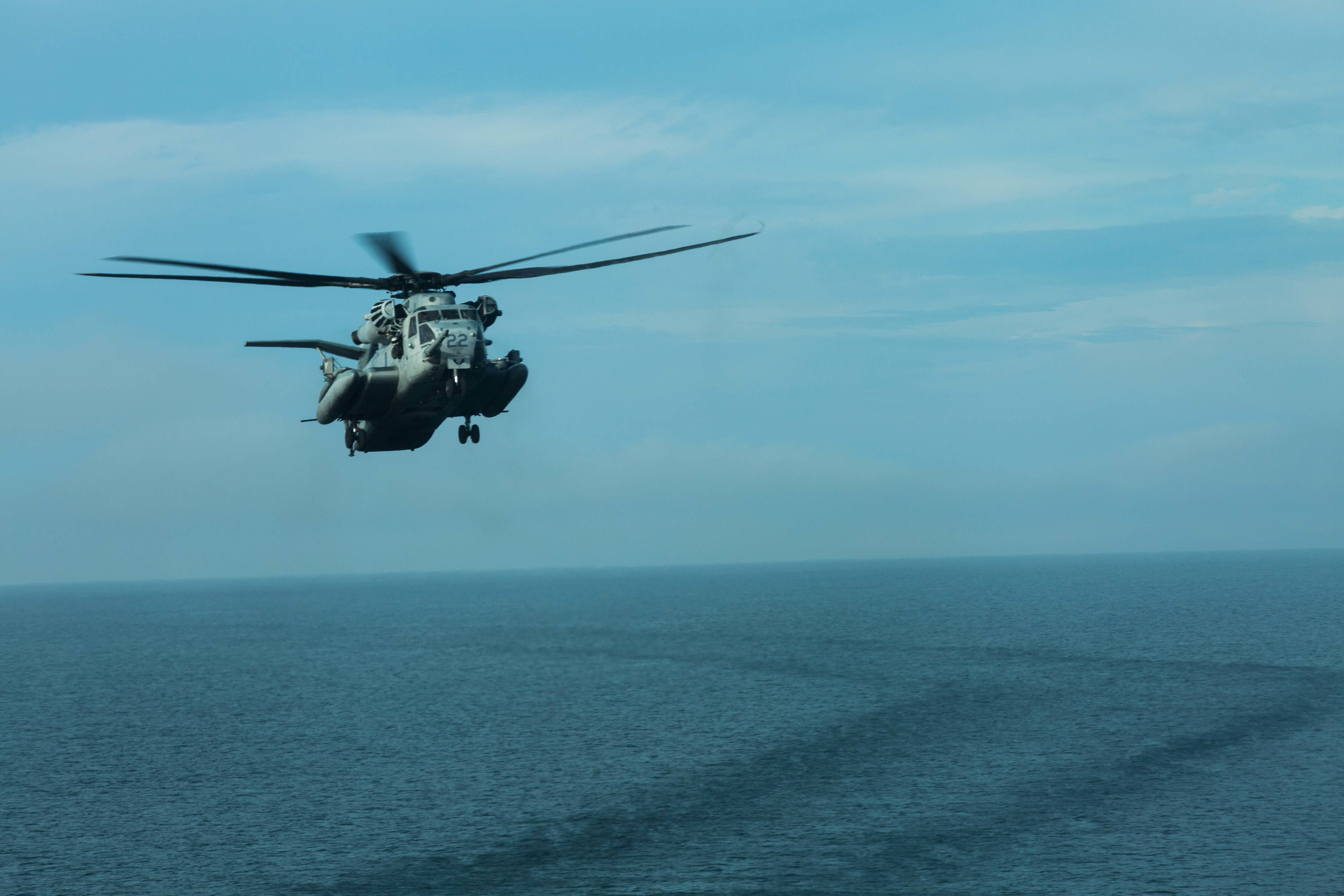 A U.S. Marine Corps CH-53E Super Stallion with Marine Medium Tiltrotor Squadron (VMM) 162 (REIN), 26th Marine Expeditionary Unit (MEU), approaches the flight deck of the amphibious landing dock ship USS New York (LPD 21) during Combined Composite Unit Training Exercise. (Cpl. Jered T. Stone/Marine Corps)