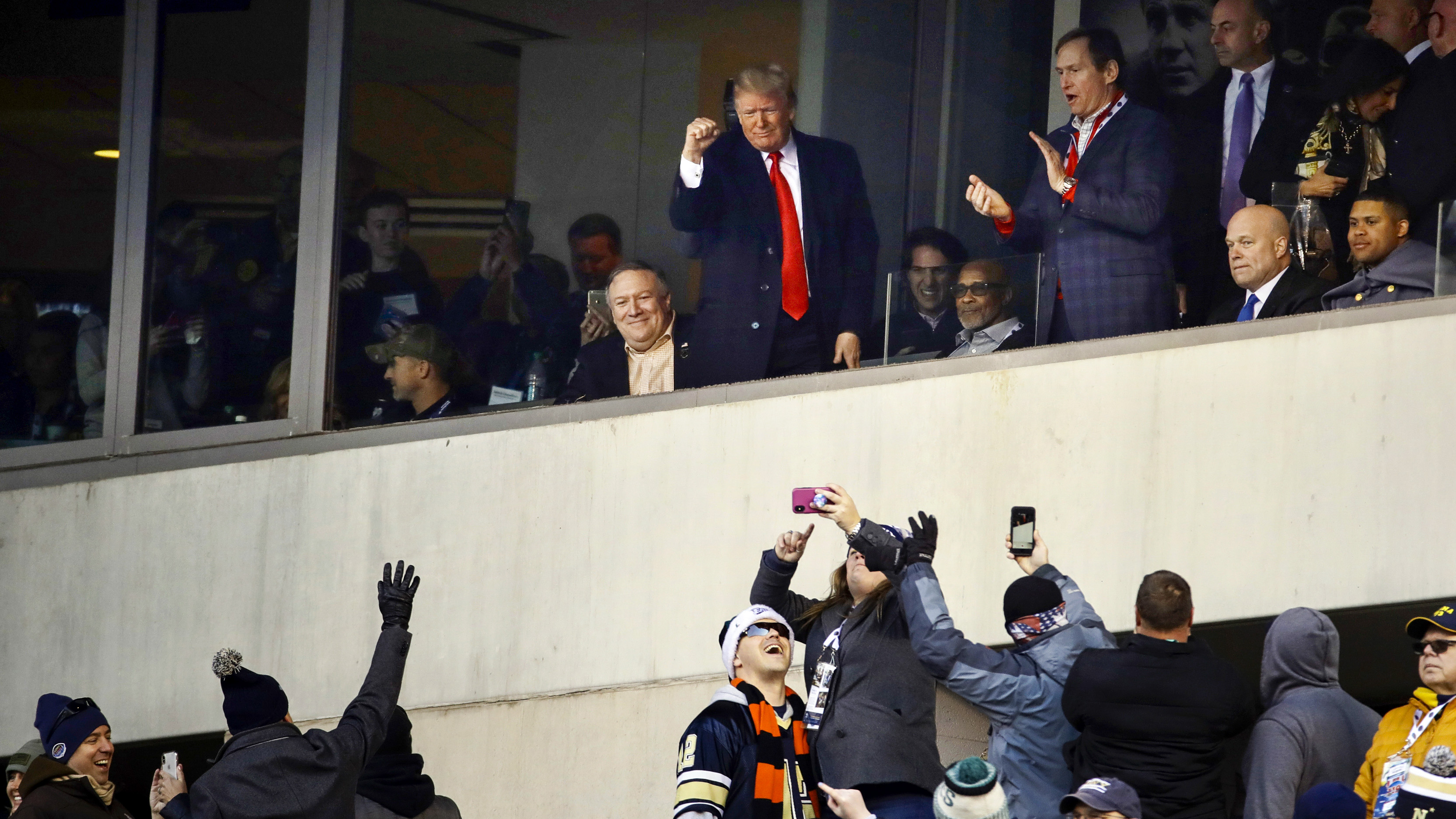 President Donald Trump, top center, gestures to the crowd during the first half of an NCAA college football game between Army and Navy, Saturday, Dec. 8, 2018, in Philadelphia. (AP Photo/Matt Rourke)