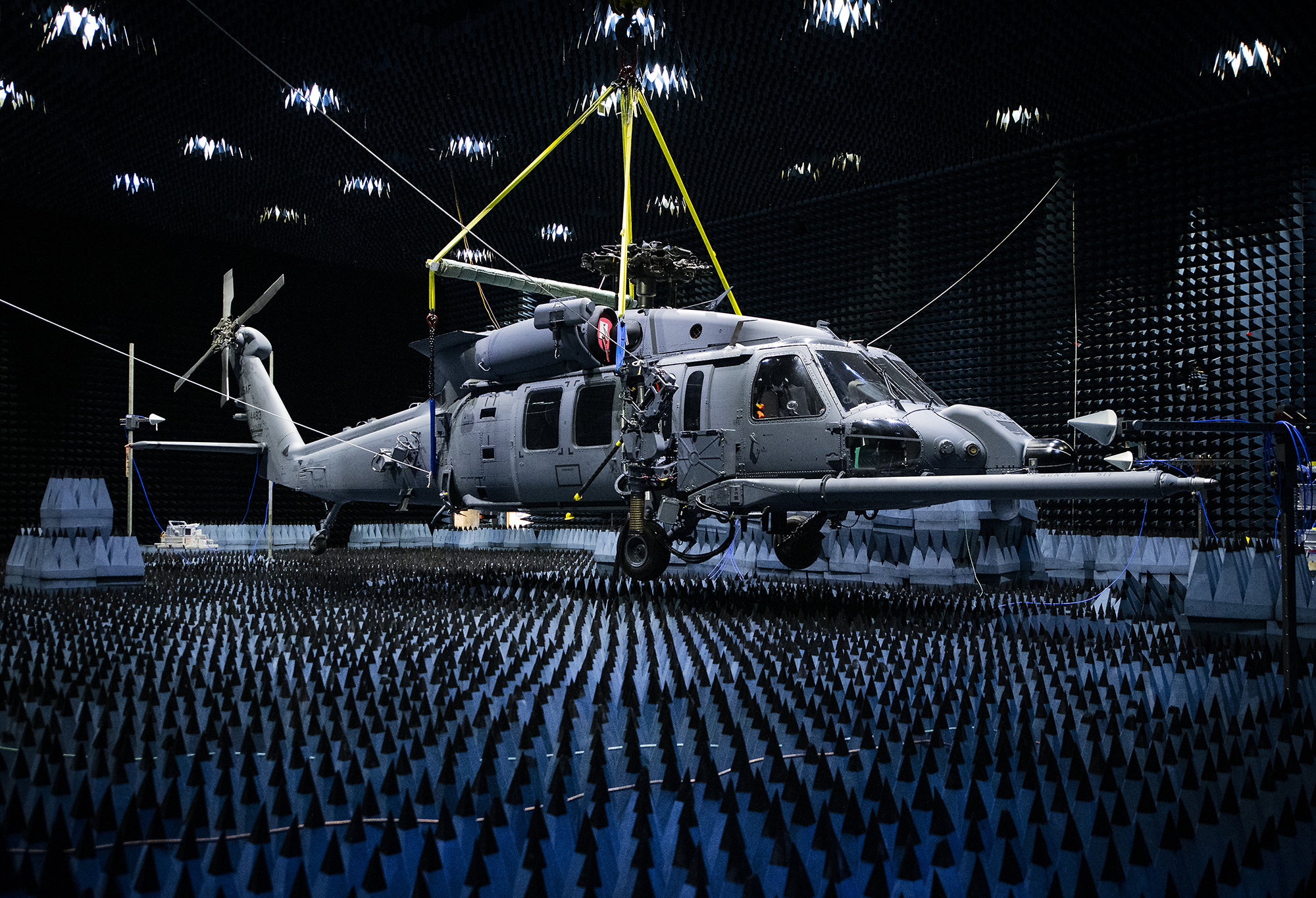 A 413th Flight Test Squadron HH-60W hangs in the anechoic chamber at the Joint Preflight Integration of Munitions and Electronic Systems hangar Jan. 6, 2020, at Eglin Air Force Base, Fla. (Samuel King Jr./Air Force)