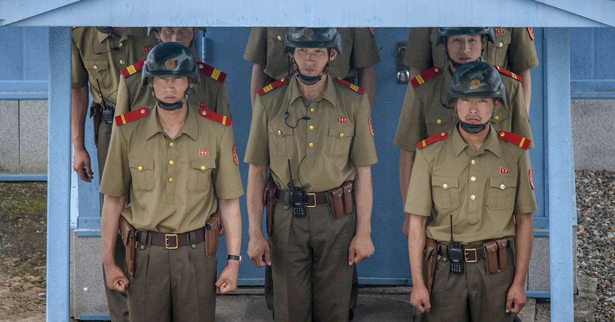 North Korean Army soldiers stand beneath the entrance to a pavilion before the Military Demarcation Line at the truce village of Panmunjom on the North Korean side of the Demilitarized Zone on June 11, 2018. (Ed Jones /AFP via Getty Images)