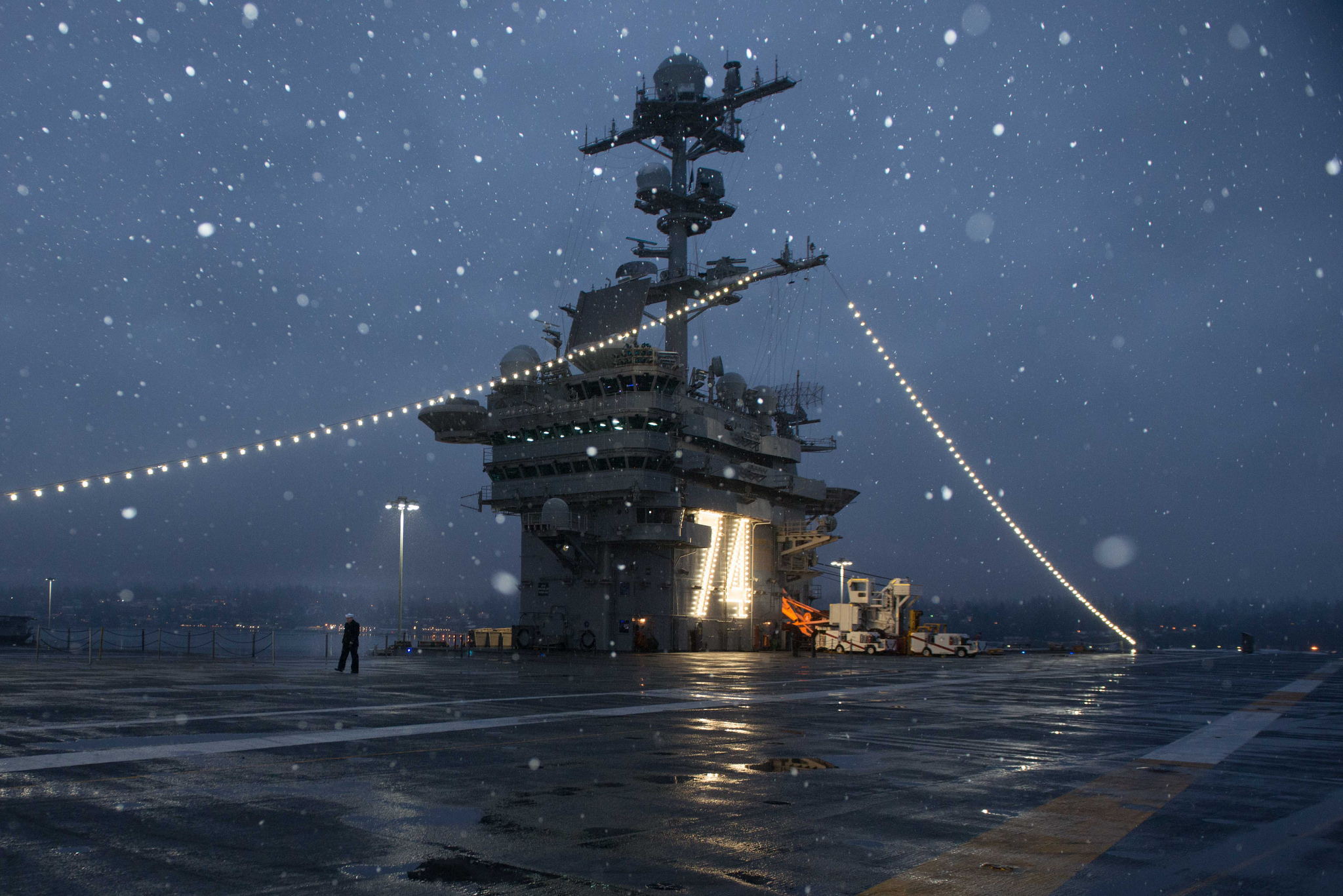 A Sailor walks across the flight deck of the aircraft carrier USS John C. Stennis (CVN 74) after being relieved from watch. John C. Stennis is in port conducting routine training as it continues preparing for its next scheduled deployment. (Mass Communication Specialist Seaman Erika Kugler/Navy)
