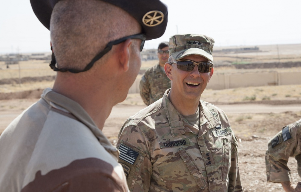 U.S. Army Lt. Gen. Stephen Townsend, commanding general of Combined Joint Task Force – Operation Inherent Resolve and the XVIII Airborne Corps, speaks with a French army officer and artilleryman at a tactical assembly area during a battlefield circulation in northern Iraq, Aug. 23, 2017. Photo by Cpl. Rachel Diehm/U.S. Army