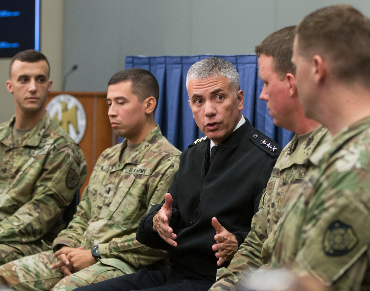 Lt. Gen. Paul Nakasone (center), the nominee to head both the National Security Agency and Cyber Command, told the Senate Intelligence Committee that splitting the two entities should only be done if in the best interest of the nation. (Mike Morones)