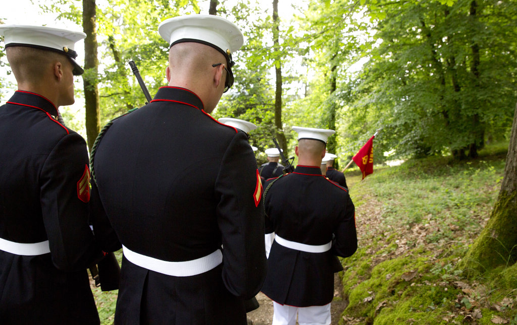 U.S. Marines walk through the battlefield of Belleau Wood prior to a Memorial Day commemoration at the Aisne-Marne American Cemetery in Belleau, France, Sunday, May 27, 2018. The cemetery contains more that 2,000 American dead. (Virginia Mayo/AP)