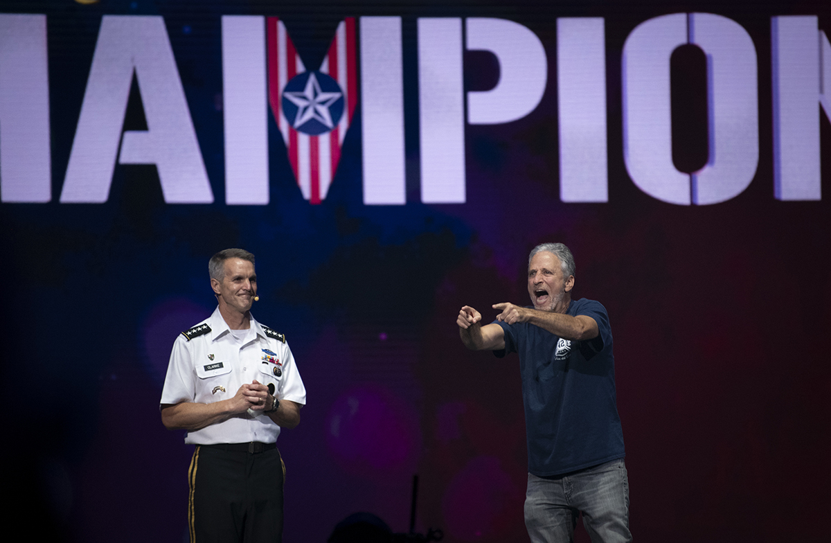 Actor John Stewart acknowledges the athletes at the 2019 DoD Warrior Games closing ceremony in Tampa, Fla., June 30. (Staff Sgt. Marianique Santos/Air Force)