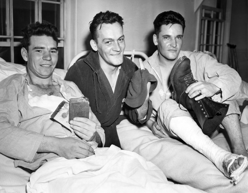 In this May 28, 1943, file photo, soldiers who took part in the American landing on Japanese-occupied Attu in the Aleutians, from left, Pvt. John E. Terknett, of Eastland, Texas, whose wallet and notebook were ripped by a shell which wounded him across the chest, Pvt. Joseph E. Kenski, of Detroit, with a finger through a knitted cap he was wearing when he suffered a head wound, and Sgt. Forrest Wright Johnson, of Flat River, Mo., showing a bullet-creased boot, smile after arriving at a Pacific Northwest Army base hospital. The 75th anniversary of American forces recapturing Attu Island in Alaska's Aleutian chain from Japanese forces will be marked on May 30, 2018. It was the only World War II battle fought on North American soil. (AP)