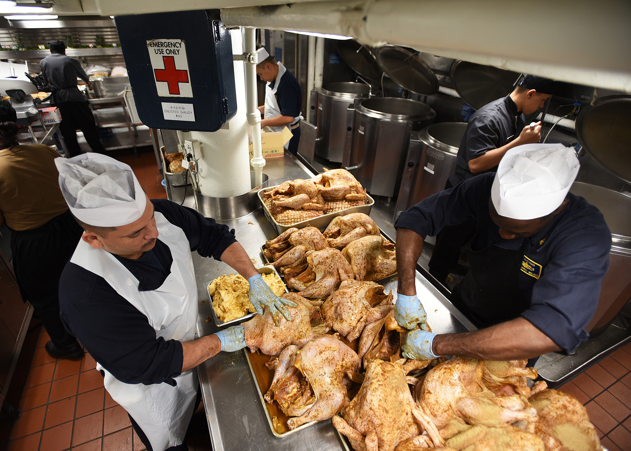 Sailors attached to the U.S. 7th Fleet flagship USS Blue Ridge (LCC 19) prepare turkeys for the ship's Thanksgiving celebration on Nov. 21, 2018, at Yokosuka, Japan. Navy culinary specialists across the fleet are preparing an estimated 112,000 pounds of roast turkey, 21,000 pounds of stuffing, 27,100 pounds of mashed potatoes, 18,500 pounds of sweet potatoes, 5,400 pounds of cranberry sauce, and 2,300 gallons of gravy. (MC3 Dylan McKay/Navy)
