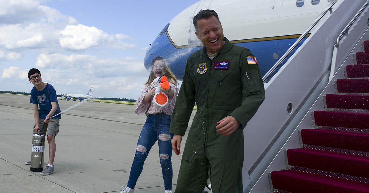 Seth and Hannah Eaton, son and daughter of Col. Casey D. Eaton, 89th Airlift Wing commander, celebrate their fathers final flight as he arrives at Joint Base Andrews, Md., June 4, 2018 upon completion of 25 years of service. Eaton was responsible for worldwide special air mission airlift, logistics, aerial port and communications support for the president, vice president, cabinet members, combatant commanders, and senior military and elected leaders. (Staff Sgt. Kenny Holston/Air Force)