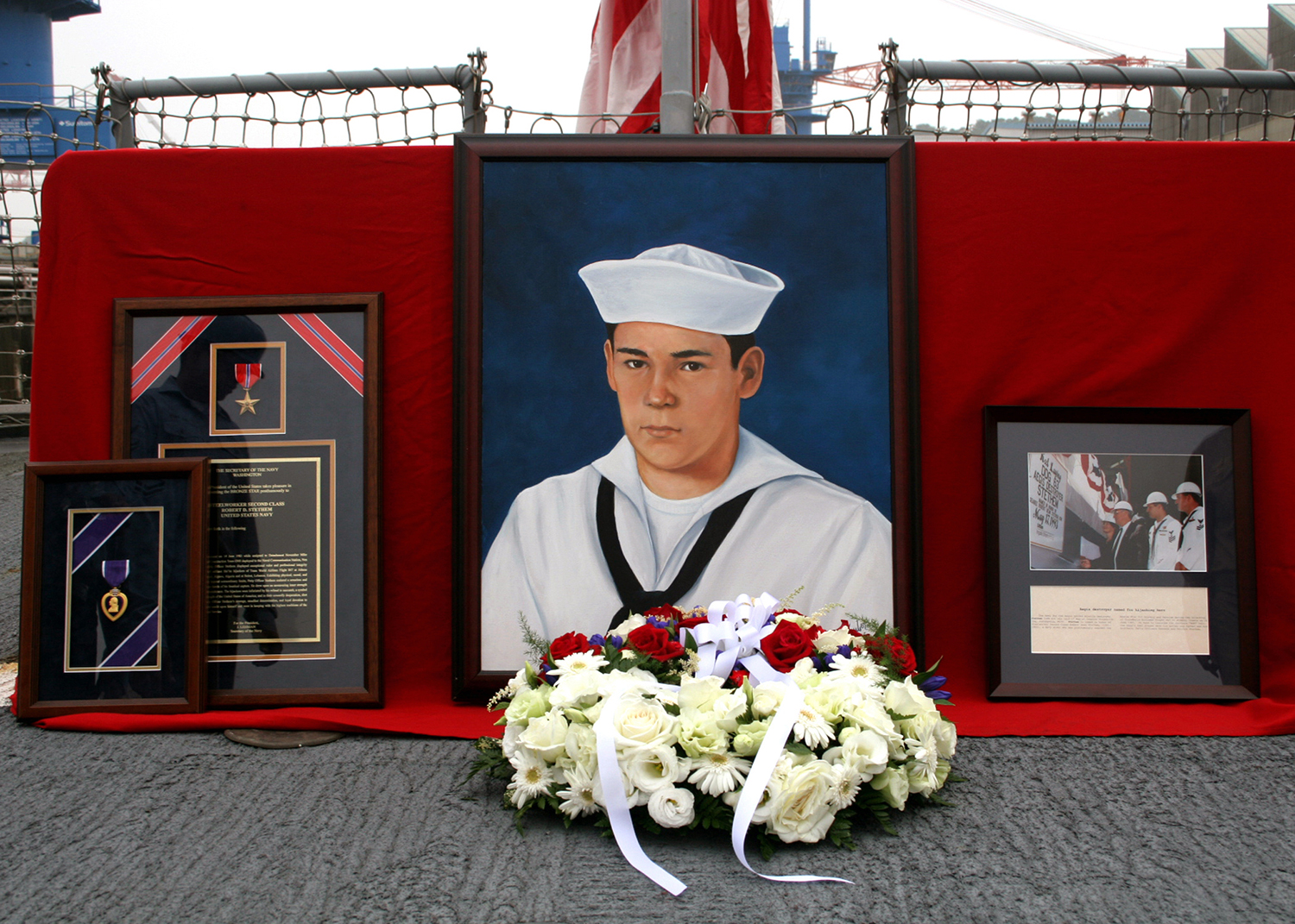 Guided-missile destroyer USS Stethem (DDG 63) sailors participate in a memorial for the ship's namesake, Robert D. Stethem, on June 15, 2006, at Yokosuka, Japan. A Navy diver, Stethem, who was returning from an assignment in the Middle East, when he was taken hostage aboard TWA 847 commercial airliner. The flight was hijacked by terrorists, and Stethem was shot to death after being tortured by the terrorists on June 15, 1985. (Ensign Danny Ewing Jr./Navy)