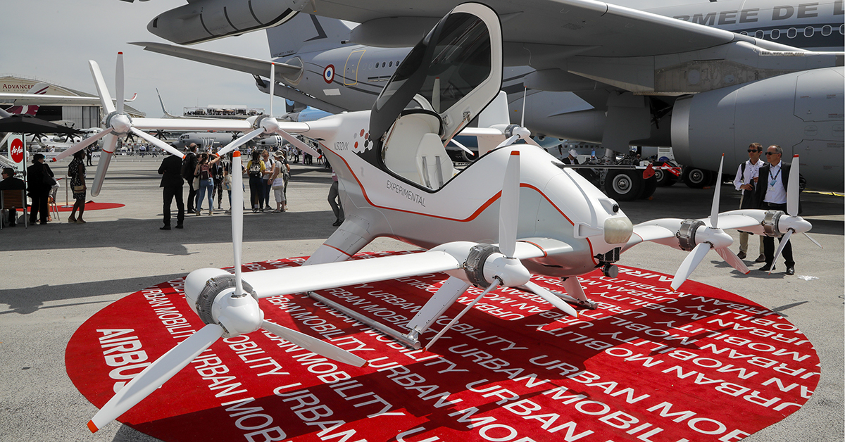A prototype of an electric unmanned air taxi is displayed at the Paris Air Show on June 18, 2019. Airbus has developed a prototype, the Vahana, an autonomous, self-piloted aircraft. (Michel Euler/AP)