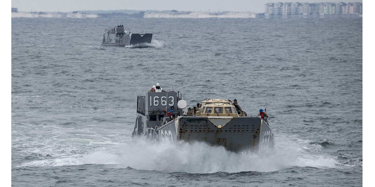 A landing craft utility assigned to Assault Craft Unit 2 approaches the amphibious assault ship Bataan as part of well deck operations during sea trials. (Mass Communication Specialist Seaman Levi Decker/Navy)