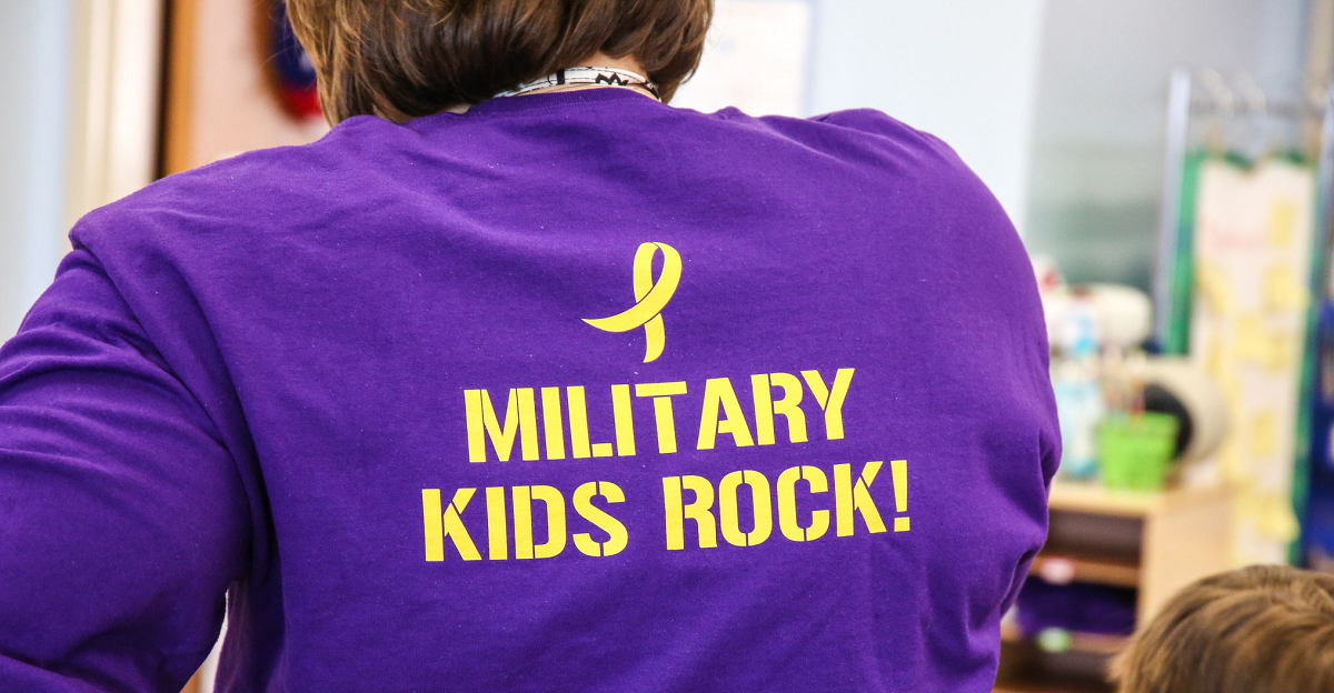 Public schools are now collecting data on the performance of military children. Here, teachers and students at Crossroads Elementary School, a DoD-run school at Quantico, Va., wear shirts honoring military children. (DoDEA)