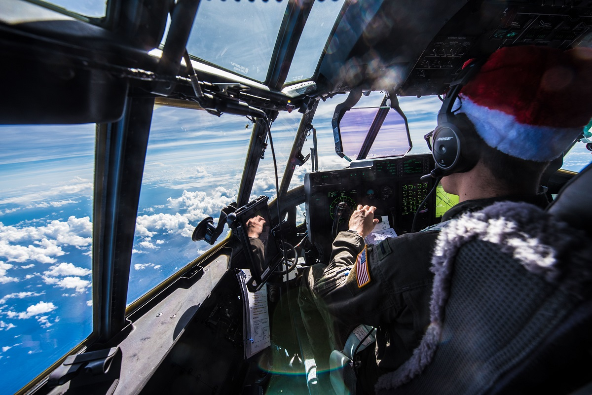 First Lt. Quinn Van Drew, C-130J first pilot assigned to the 36th Airlift Squadron, pilots his aircraft during Operation Christmas Drop, Dec. 15, 2017, above the Pacific Ocean near Guam. (Staff Sgt. Alexander W. Riedel/Air Force)
