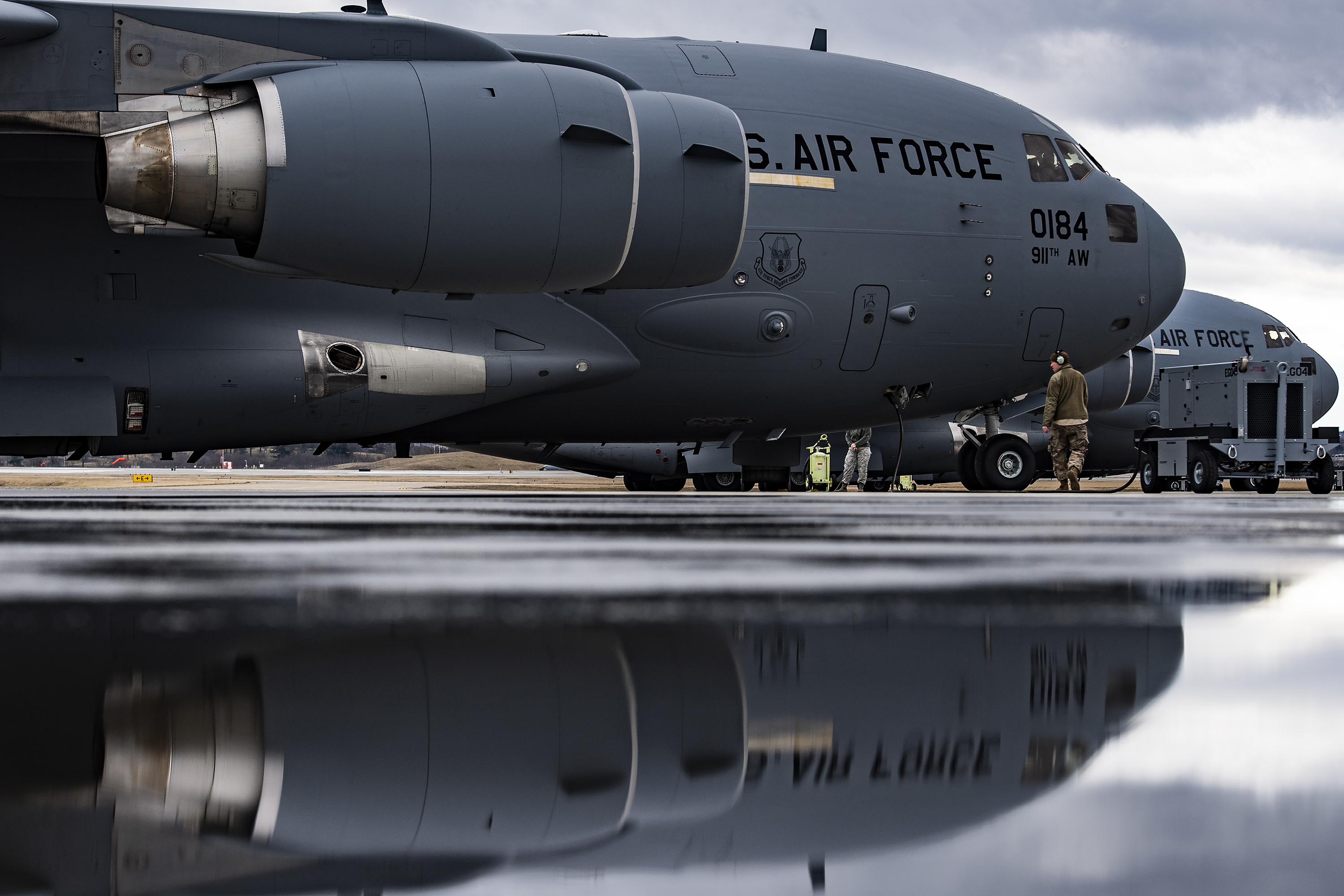 Airmen assigned to the 911th Aircraft Maintenance Squadron perform a pre-flight inspection on a C-17 Globemaster III at the Pittsburgh International Airport Air Reserve Station, Pa., March 3, 2020. (Joshua J. Seybert/Air Force)