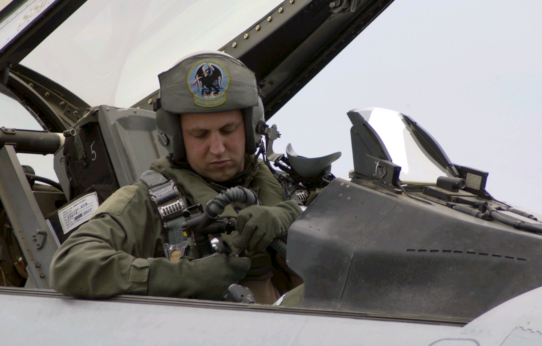 Then-Capt. Seth Nehring prepares himself for a mission in an F-16 Fighting Falcon during operation Cooperative Cope Thunder at Eielson Air Force Base, Alaska, in this July 2004 photo. Nehring was killed this week along with a Ukrainian pilot when an Su-27 aircraft crashed during an exercise in Ukraine. (Senior Master Sgt. Chris Drudge/Air Force)