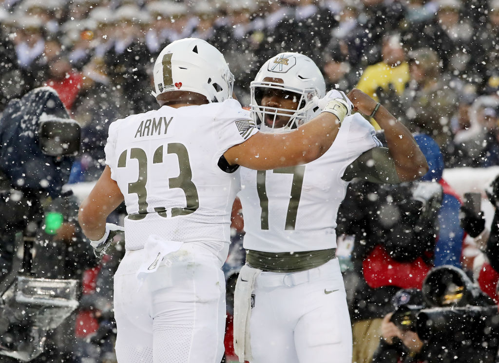 Army West Point's Darnell Woolfolk, left, and Ahmad Bradshaw celebrate after Woolfork's first-half score Saturday in Philadelphia. (Elsa/Getty Images)
