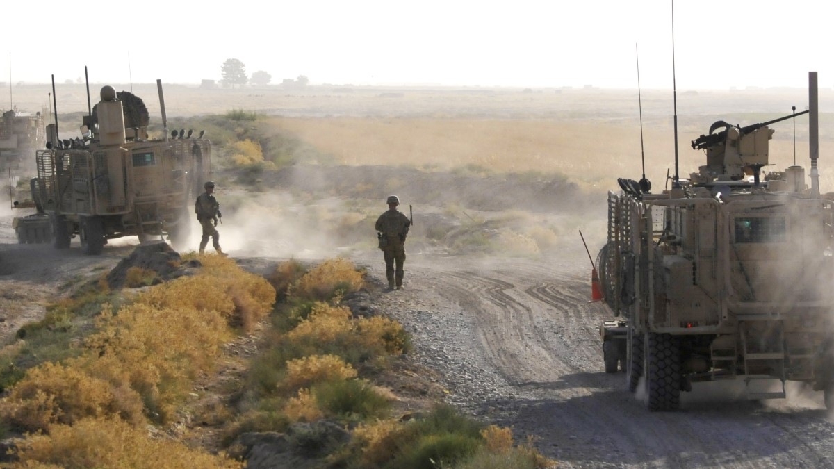 Soldiers guide route clearance vehicles over a difficult stretch of road in Afghanistan. (Maj. Luke Talbot/Army)