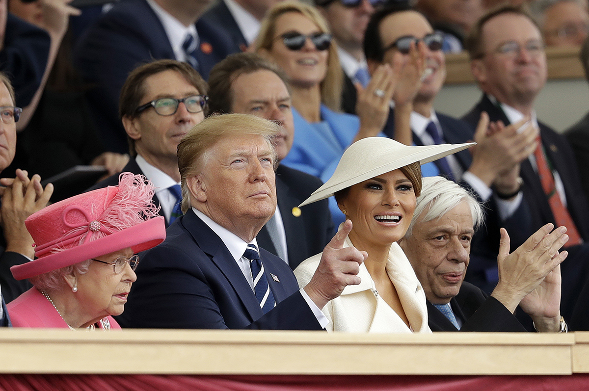 Queen Elizabeth II, President Donald Trump, first lady Melania Trump and Greek President Prokopis Pavlopoulos, from left, applaud as they watch a fly past at the end of an event to mark the 75th anniversary of D-Day in Portsmouth, England, Wednesday, June 5, 2019. World leaders including U.S. President Donald Trump are gathering Wednesday on the south coast of England to mark the 75th anniversary of the D-Day landings. (Matt Dunham/AP)