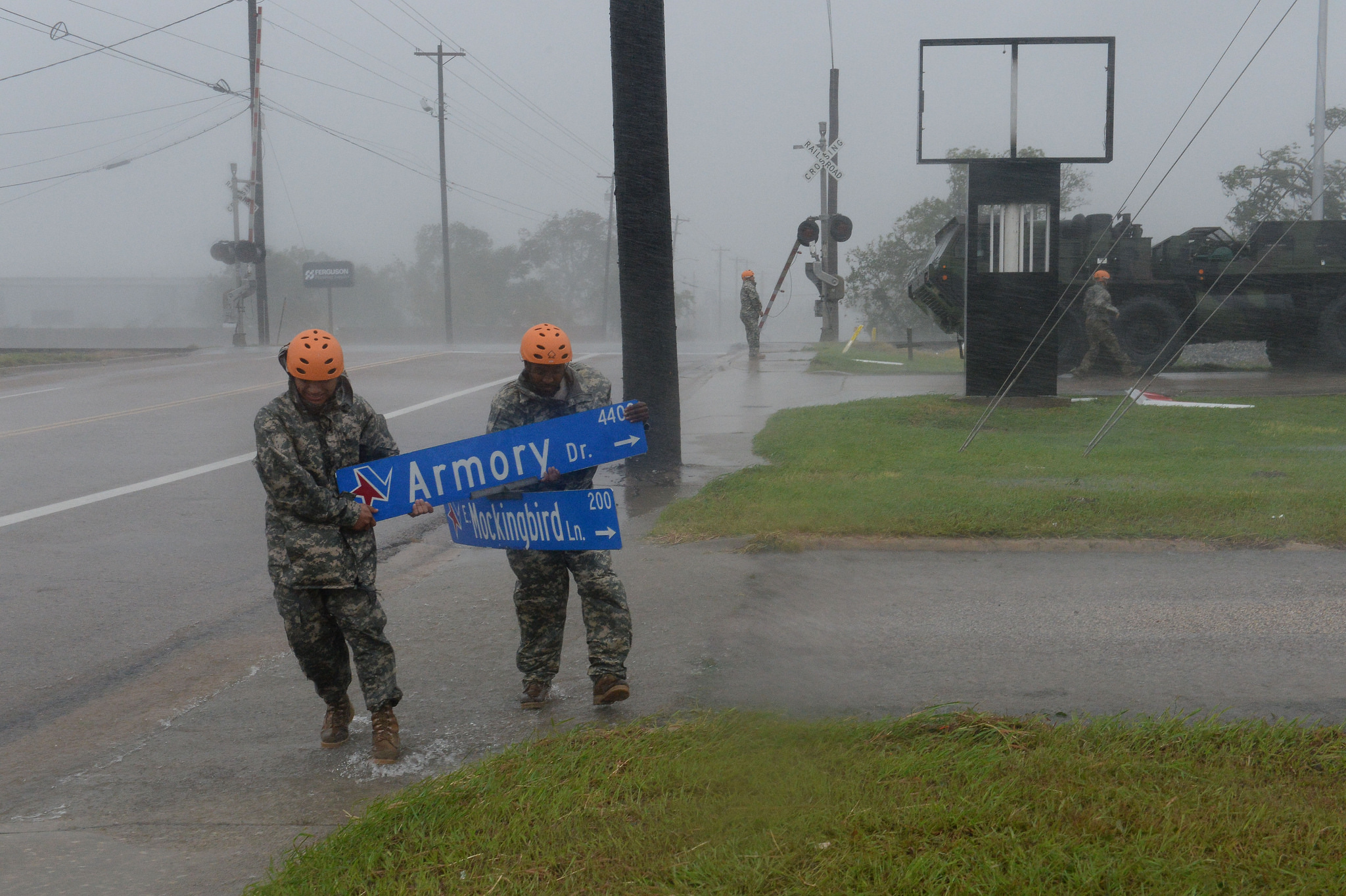 Texas National Guardsmen from the 386th Engineer Battalion pick up large debris following Hurricane Harvey in Victoria, Texas, Aug. 26, 2017. (Capt. Martha Nigrelle/Army National Guard)