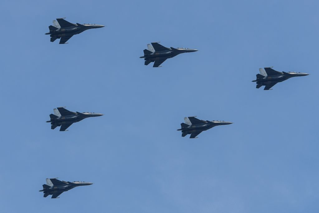 Royal Malaysian Air Force Su-30MKM fighter aircraft fly in formation during the country's National Day celebration parade in Putrajaya on August 31, 2019. - Malaysia on August 31 celebrated its 62nd National Day marking the country's independence from British colonial rule. (MOHD RASFAN/AFP/Getty Images)